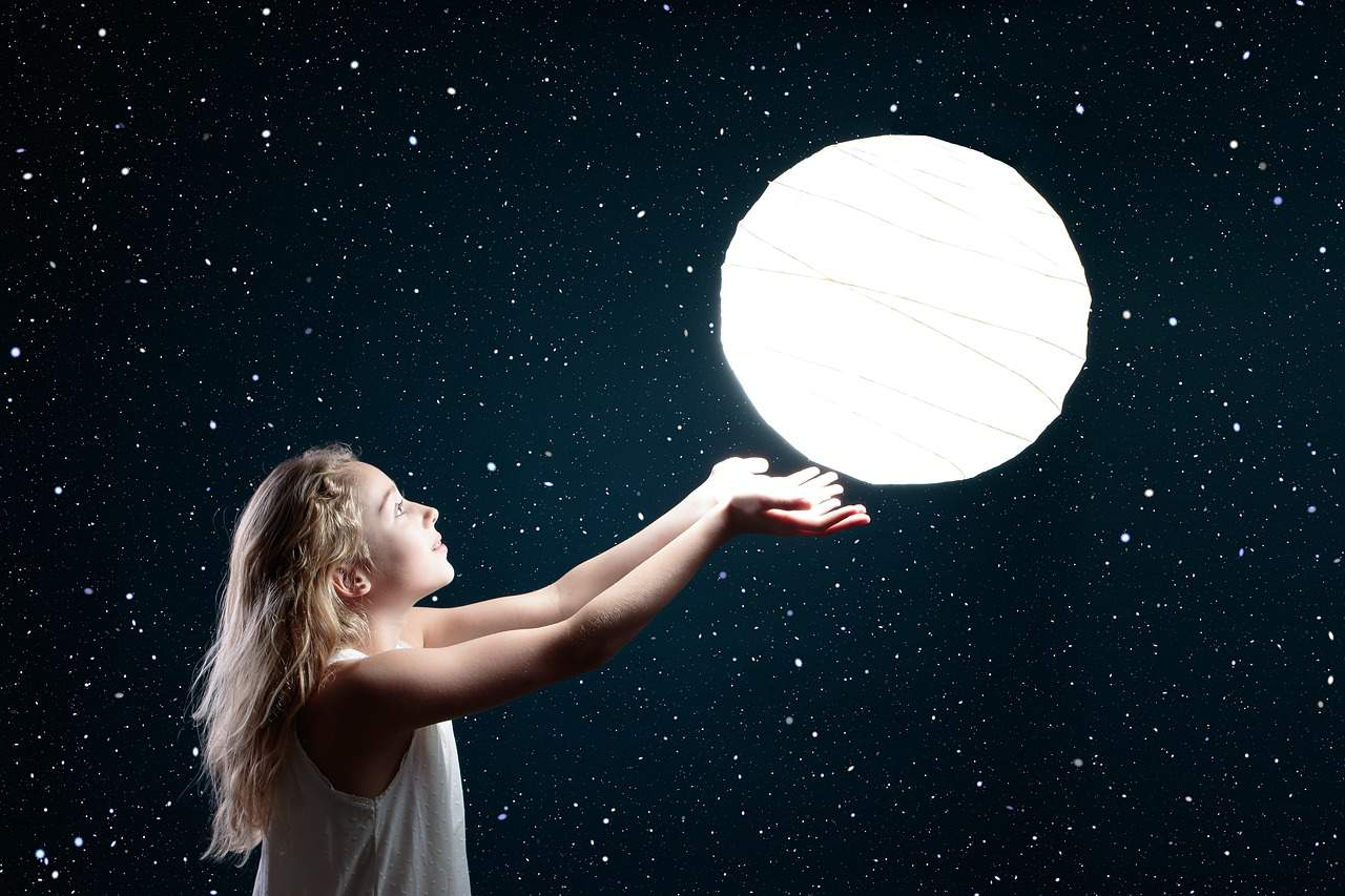 kid trying to catch the moon