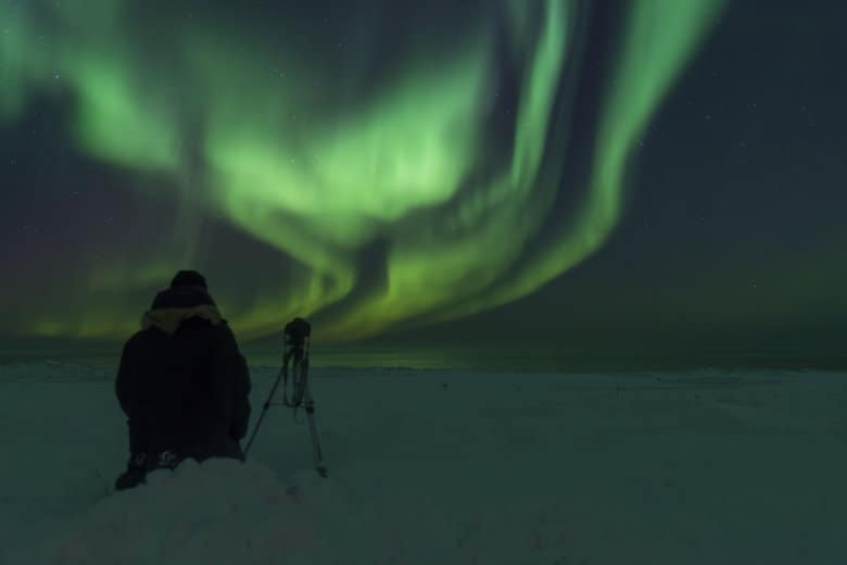 setting up equipment for photographing northern lights