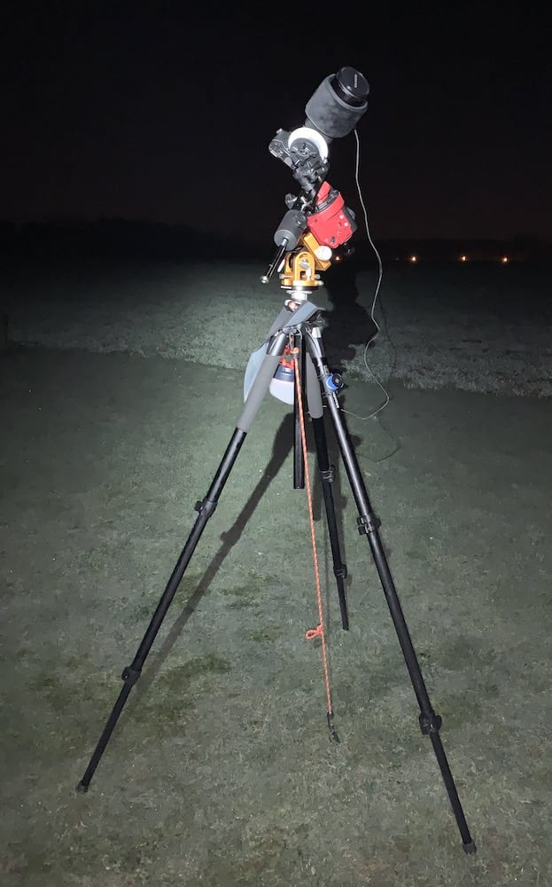 using a bungee cord to pin down a tripod