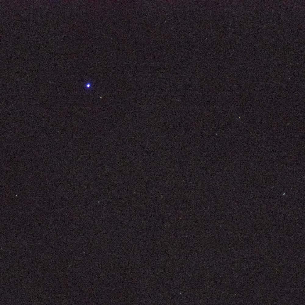 blue halo Chromatic aberration is visible around the brightest star