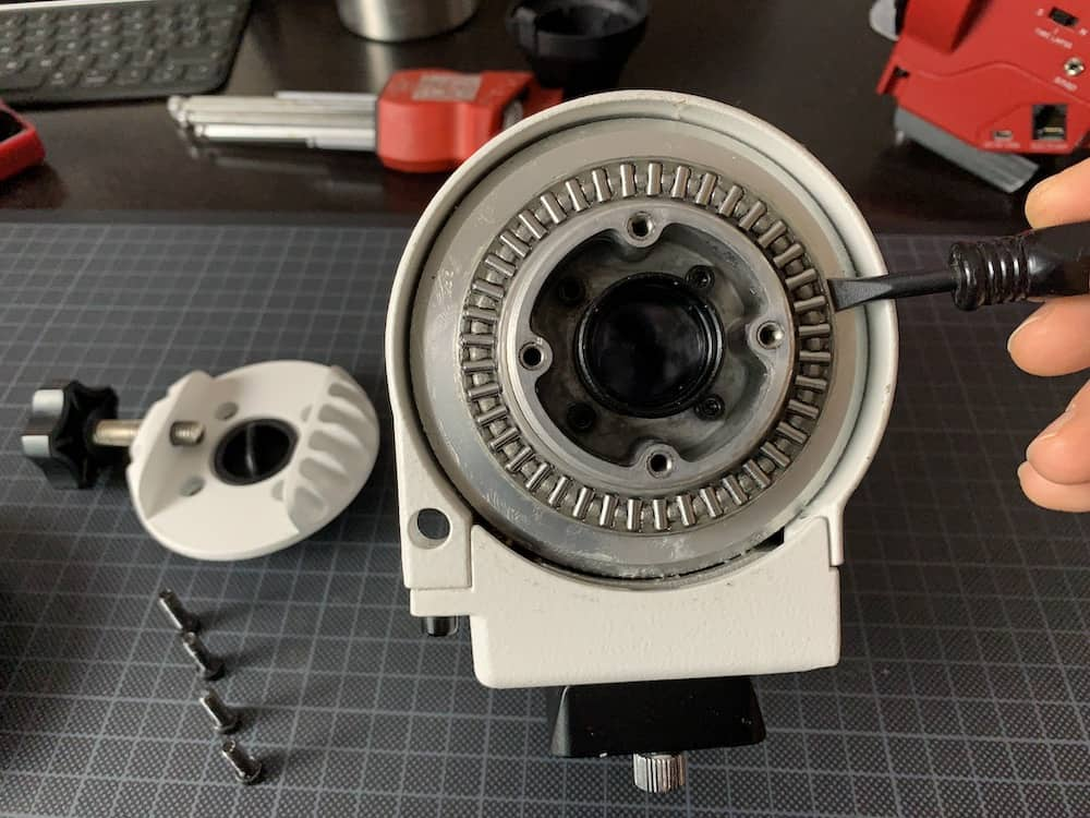Use a flat screw driver to help you remove the bearings ring