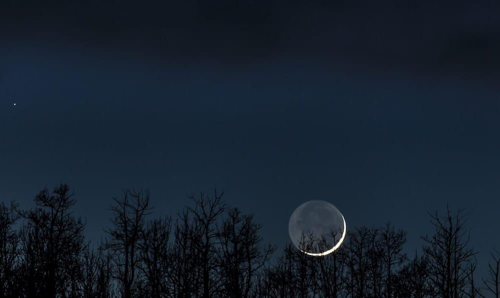 Earthshine illuminating most of the Moon