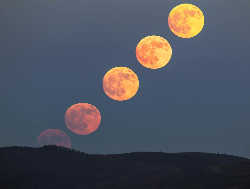 The Moon changes color as it climbs high in the sky