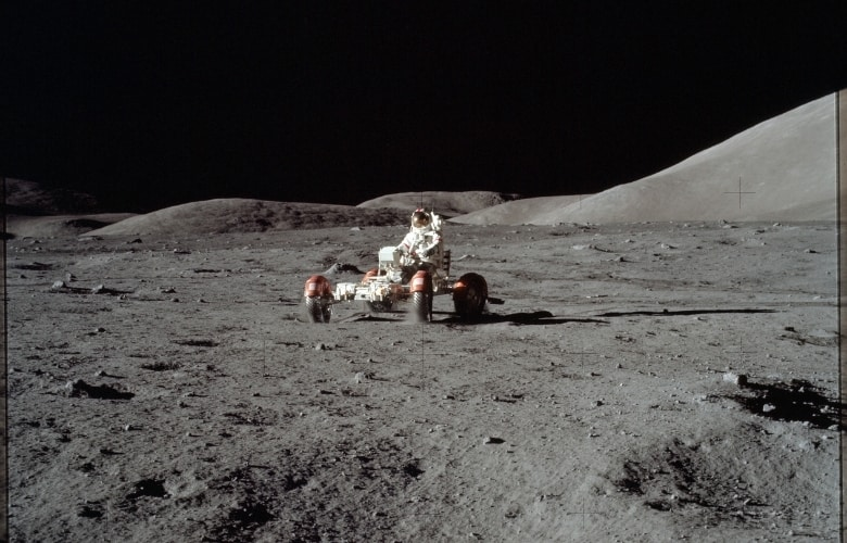 Astronaut Eugene Cernan drives the Lunar Roving Vehicle during first EVA