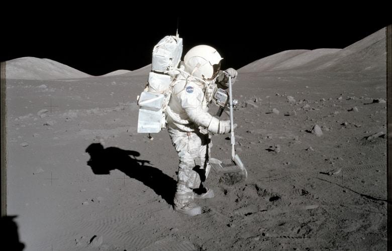Astronaut Schmitt collects lunar rake samples