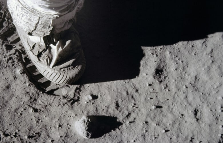 Close-up view of astronauts foot and footprint in lunar soil after uSA landed on moon