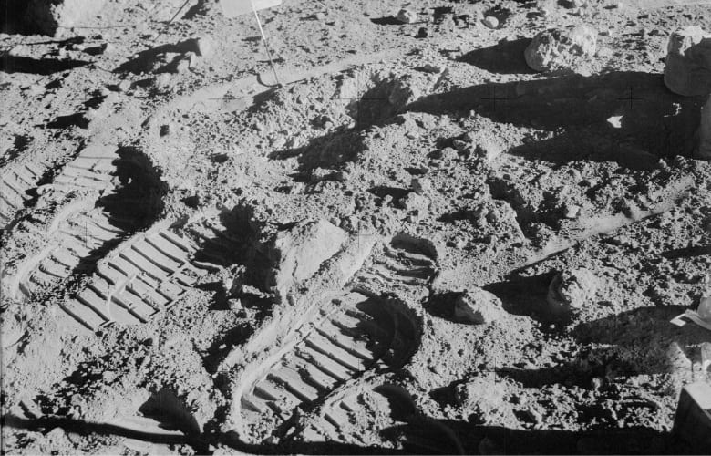 Close-up view of lunar soil and boot prints made by Apollo 14 crew
