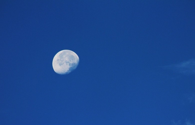 Waning Gibbous Moon on Blue Sky