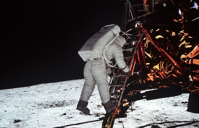 Astronaut Edwin E. Aldrin Jr. descends the steps of the Lunar Module (LM) ladder as he prepares to walk on the moon.