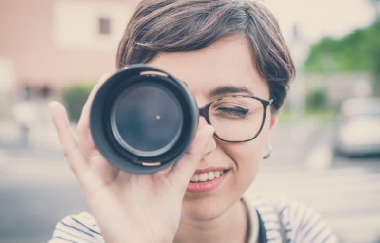 A woman looks through a monocular
